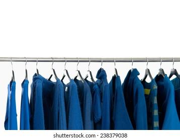 Set of female blue dress and coat isolated on hanging