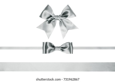 Set for festive decorations with gift satin bows and ribbons silver color on white background
