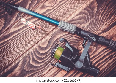 set of fishing tackle on a wooden table