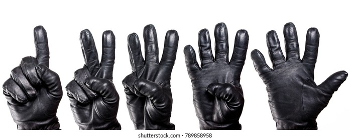 Set of five hands in black leather glove showing numbers isolated on white.