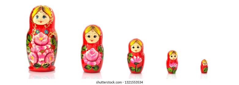 Set of five matryoshka russian nesting dolls isolated on panoramic white background