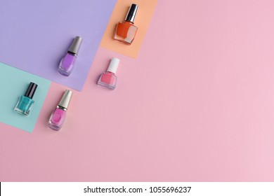 Set of five nail lacquers. Pastel and bright colors for different ocassion. Cosmetic products background with copy space.