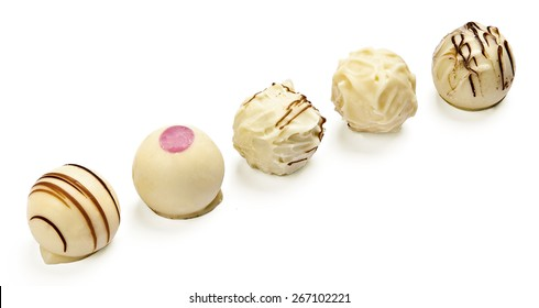 Set of five white chocolate pralines isolated