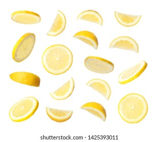 Set of flying cut fresh juicy lemon on white background