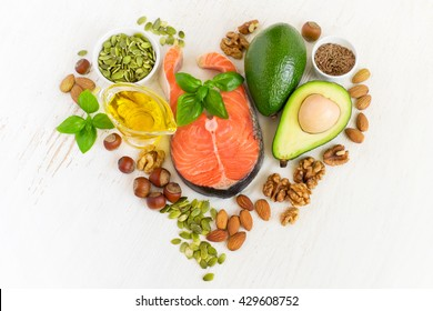 set of food with healthyl fats and omega-3, laid out in the shape of a heart. Health concept