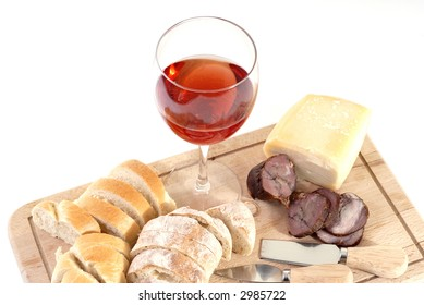 A set of food with red wine isolated on white