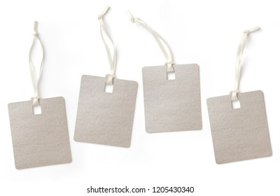 set of four elegant blank glitter hangtags in different positions isolated on a white background, subtle shadows, copyspace for text or single letters, e.g. SALE