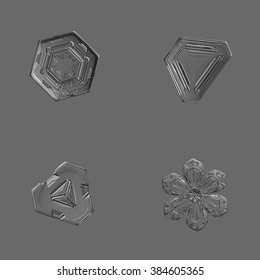Set with four real snowflake photos (monochrome version), isolated on gray background.