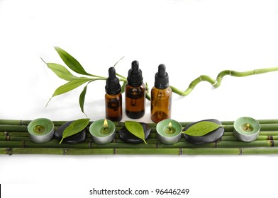 Set of fresh bamboo leaf and massage oil with candle bamboo grove