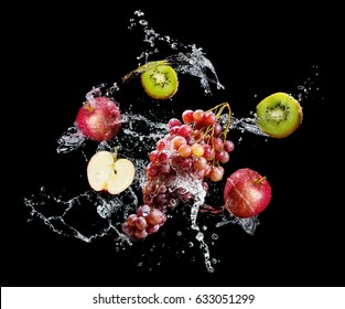 Set of fresh fruits in water splash over black background
