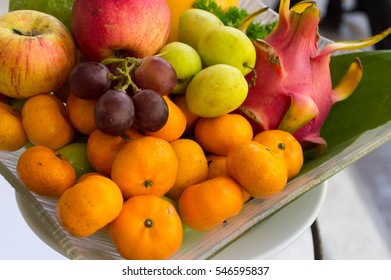 set of fresh mix fruit in white plate at local restaurant
