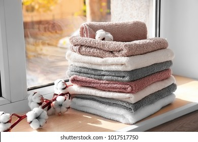Set of fresh towels on window sill