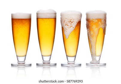 set of frosty glass of light beer with foam on white background
