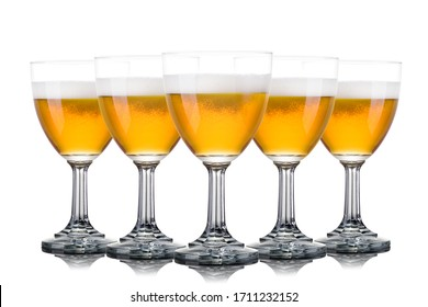 Set of frosty glasses of light beer with foam isolated on a white background.