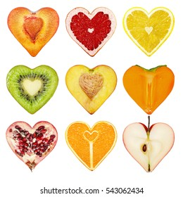 A set of fruit in the form of heart (orange, lemon, persimmon, apple, kiwi, plum, peach, pomegranate, grapefruit)