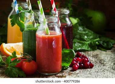 Set of fruit and vegetable juices, old wooden background, selective focus
