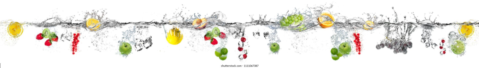 A set of fruits falling in the water on a brown background panorama.