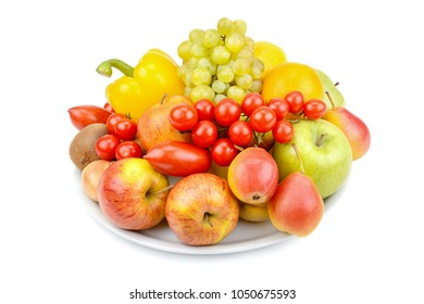 A set of fruits and vegetables on a platter isolated on white background.