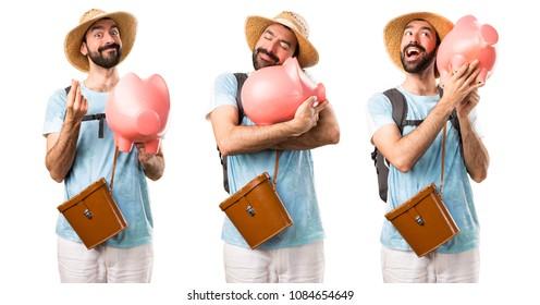 Set of Funny tourist holding a piggybank