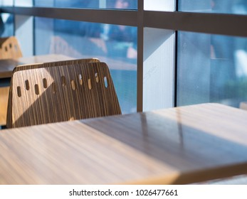 a set of furniture, table and chair with the wooden print next to the window with on the sunny day. interior and product design concept. Selective focus on chair