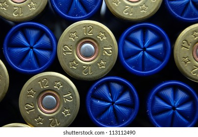 Set of game cartridges for hunting, concept of good team for business (team work). Shotgun cartridge of 12 gauge, rifle ammo background.