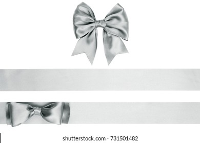 Set of gift bow and ribbon, silver satin, on white background