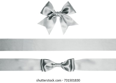 Set of gift silver satin bow and ribbon on white background