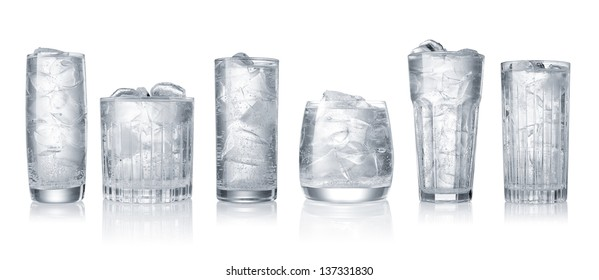 set of glases of water with ice cubes isolated on white background