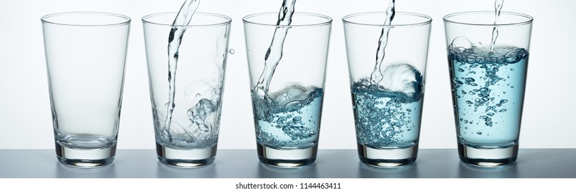 Set of glass is filling up with water