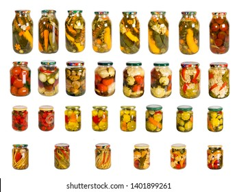 Set from a set of glass jars with canned vegetables on a white background.