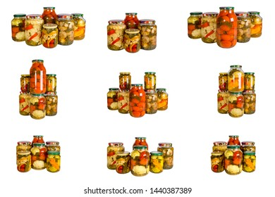 Set from of glass jars with canned vegetables on a white background.