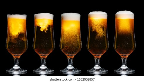 Set of Glasses of Beer Isolated on Black Background
