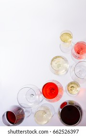 Set of glasses with red, white and rose wine, top view scene with copy space