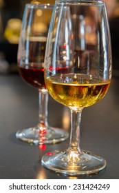 set of glasses of white and ruby port wine