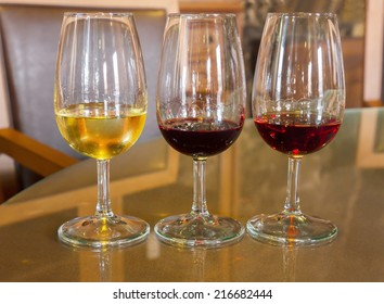 set of glasses of white , ruby and reserva  port wine