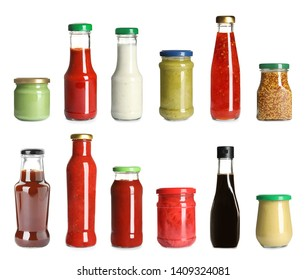 Set of glassware with different delicious sauces on white background