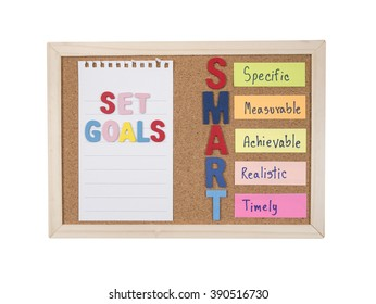 Set Goals and SMART Goals with cork board on isolated / white background