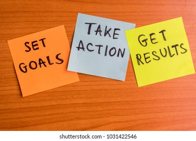 Set goals, take action and get results written on a blank notes post it on wooden background. Business plan concept.