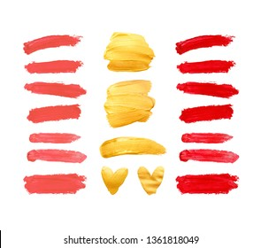 Set of gold, red and living coral strokes isolated on white background. Lipstick bullet smudged. Beautiful textured brush strokes and hearts.