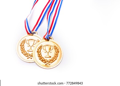 Set of golden circle medals with blue red ribbons on isolated white background for award, winning or success achievement concept