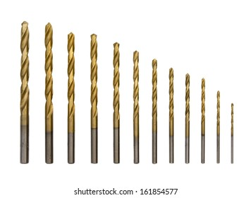 Set of golden drill bits on white background