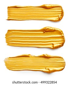 Set of golden paint strokes isolated on white background