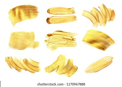 Set of golden paint strokes for your design. Isolated on white background. Each element can be used also like background for text.