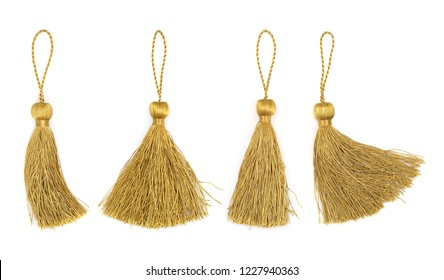 Set of golden silk tassels isolated on white background for creating graphic concepts