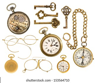 set of golden vintage collectible accessories. antique keys, clock, compass, glasses isolated on white background