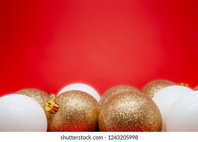 Set of golden and white Christmas tree decorations on a red background with space for text