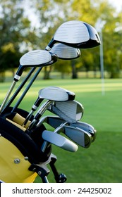 A set of golf clubs on a golf course on a beautiful sunny day