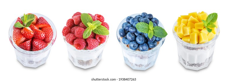 Set of Greek yogurt granola parfaits with strawberries, blueberries, mango fruits and raspberries in a glass on a white isolated background. toning. selective focus
