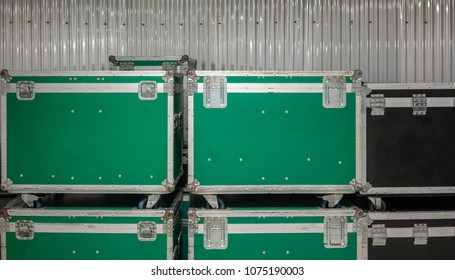 Set of green and black aluminium wooden flight cases. Musical instrument cases.