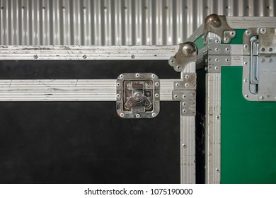 Set of green and black aluminum wooden flight cases. Musical instrument cases.